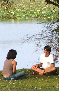 Students sitting by the lake